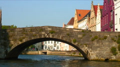 Colorful buildings and a bridge over a canal in Bruges, Belgium. Stock Footage