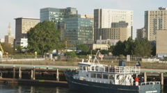 Boston with a boat and dock in the foreground. Stock Footage