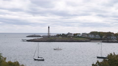 Marblehead light and a few boats in the harbor in Massachusetts. - stock footage