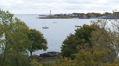 Marblehead light tower at the end of the harbor in Massachusetts. - stock footage