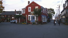Two women strolling by the red Pewter Shop in Rockport, MA. Stock Footage