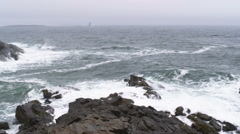 Pan of the coast with the Portland Head Light in Maine. Stock Footage