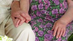 Grandfather gently stroking grandmother hands. Old hands. Stock Footage