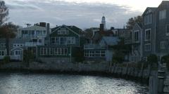 Buildings around the end of Rockport Harbor at sundown. Stock Footage