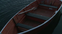 Red wooden rowboat at a dock in Rockport Harbor. - stock footage