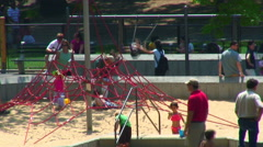 Children and parents at a playground. Stock Footage