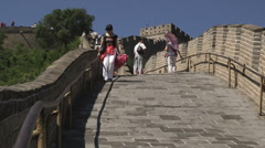 Woman walking down a decline at the Great Wall of China. Stock Footage