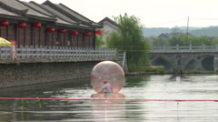 Giant plastic ball for walking on a river. Stock Footage