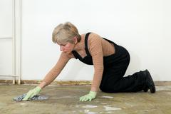 House work, woman cleaning floor Stock Photos