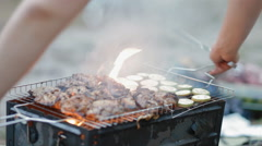 Turning around the cell   on bbq Stock Footage