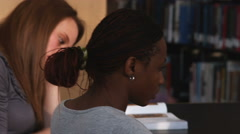 Close-up dolly shot of students studying. - stock footage