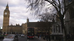 Traffic passing by Palace of Westminster in London. Stock Footage