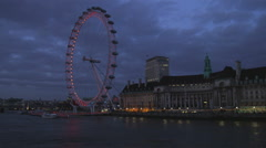 London cityscape including the London Eye at night. Stock Footage