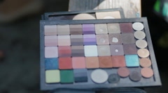 Palette of colorful cosmetics, brushes for make up - stock footage