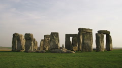 Tilt up from Stonehenge in England. Stock Footage
