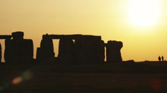 Wide shot pan of Stonehenge at sunset. Stock Footage