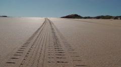 Tyre track on beach desert sand Stock Footage