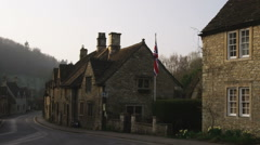 Stock Video Footage of Pan of old stone buildings in the countryside of England.