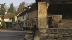 Pan of old stone buildings in a village in England. - stock footage