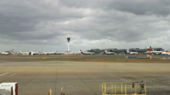 Airport and tarmac with storm clouds in the sky of England. Stock Footage