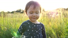 Mom gives little child drink clean pure water on nature sunset - stock footage