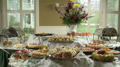 Delicious looking desserts on a table. Stock Footage