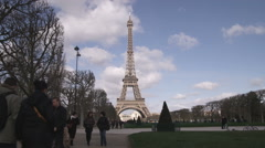 Eiffel Tower and silhouetted people and trees. Stock Footage