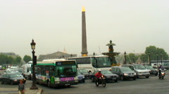 Cars driving by a monument in Paris. Stock Footage