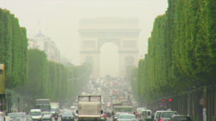 Vehicles driving under an archway in Paris. Stock Footage