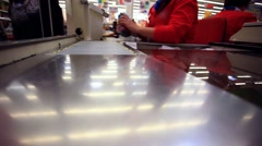 Woman with groceries waiting in line at the supermarket checkout Arkistovideo