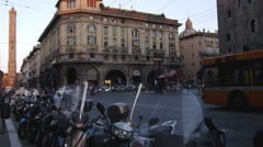 Busy city street with a row of motorcycle in Bologna Italy. Stock Footage