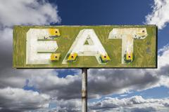 Faded Vintage Eat Sign - stock photo