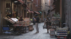 Panning shot of an alley market in Bologna Italy. Stock Footage