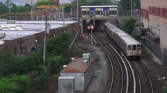 New York City Subway Train Pulls Into Railroad Station Staten Island Stock Footage
