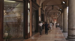 People walking through a mall hall in Bologna Italy. Stock Footage