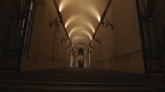 People walking up a dark staircase in Bologna Italy. Stock Footage