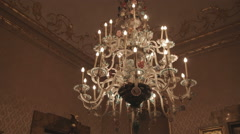 Fancy bedroom with a chandelier in Bologna Italy. Stock Footage