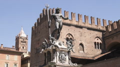 Man standing at the base of a statue in Bologna Italy. Stock Footage