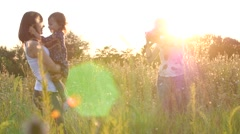 Girl photographer nature shooting process with family mother and little child Stock Footage