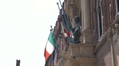 Italian flag on an old building in Bologna Italy. Stock Footage