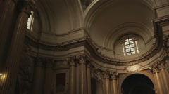 Tilt from ceiling to stairs in a cathedral in Bologna Italy. Stock Footage