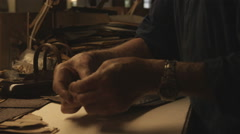 Clip of a craftsman working on a bag in Italy. Stock Footage
