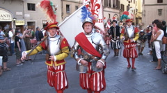 Men in fancy attire in a parade in Italy. - stock footage