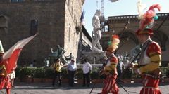 Stock Video Footage of Men in fancy attire carrying flags in a parade in Italy.