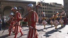 Stock Video Footage of Shot of men in fancy attire playing instruments in a parade in Italy.