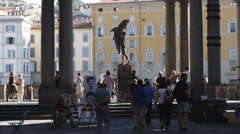 Plaza and columns with people and statue in italy. Stock Footage