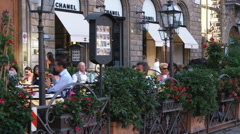 People eating outside a restaurant in Italy. Stock Footage