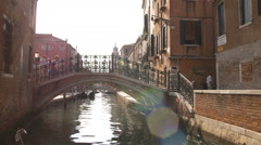 Boat passing under a bridge in Venice. Stock Footage