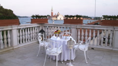 Dolly shot of a table and chairs on a deck in Venice. Stock Footage