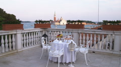 Table and chairs on a deck in Venice. Stock Footage